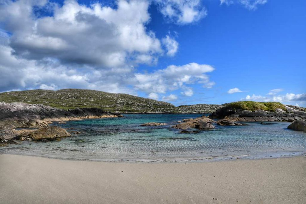 """derrynane irlanda piccola baia sabbia bianca acqua turchese"""